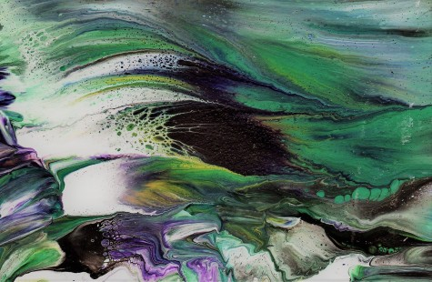 Paper dipped in excess paint from acrylic pour